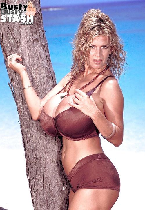 Chesty mature beach model Busty Dusty stripping off bikini outdoors