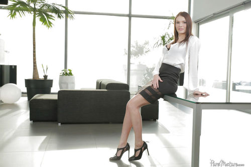 Mature secretary Kitana Lure modeling for babe photo shoot in office