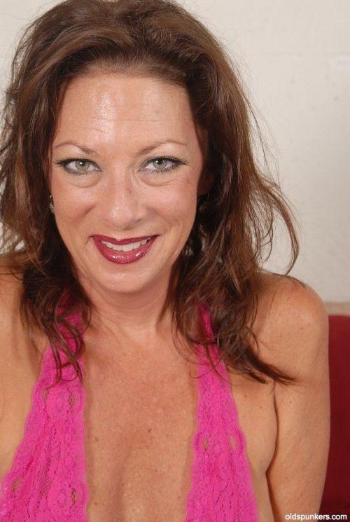 Brunette Margo is showing off her nice-looking big natural boobies