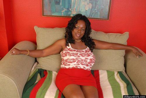Fatty ebony Yvette shows her awesome big natural boobies on sofa