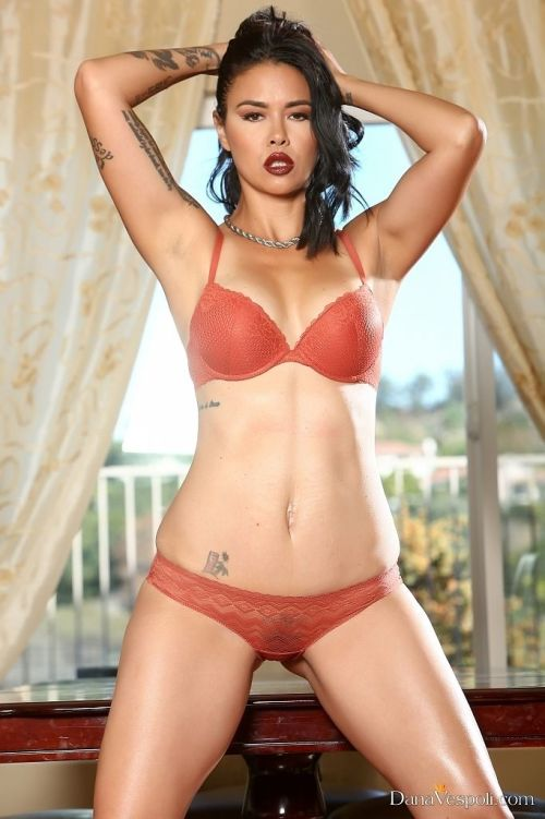 Hot Asian model Dana Vespoli strips off her red lingerie before masturbating