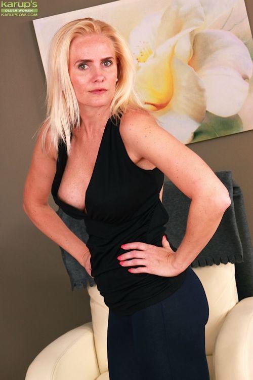 Top heavy older blonde Sevikova baring big boobs and trimmed twat
