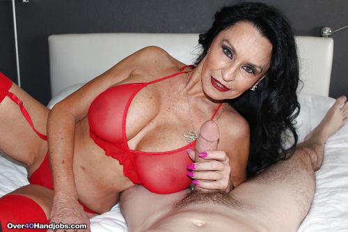 Busty mature pornstar Rita Daniels jerking big cock to cumshot finale